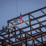 The final steel beam is set in place on the new Engineering & Science Building. (Christopher Larosa)