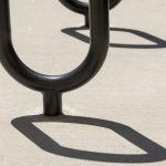 Shadows from a bicycle rack on July 26, 2016. (Sean Flynn/UConn Photo)