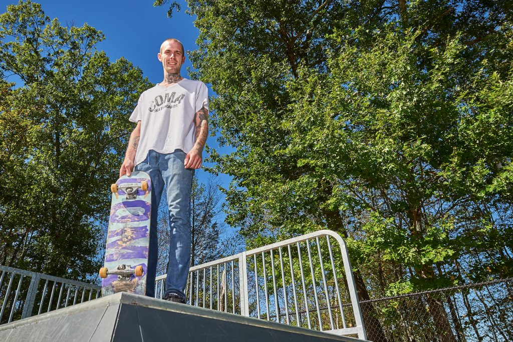 Bent Cordy with one of his Coma skateboards at the Mansfield Skate Park on Sept. 25, 2016. (Peter Morenus/UConn Photo)