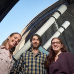 New assistant professors of physics Kate Whitaker, left, Jonathan Trump, and Cara Battersby are building UConn's first world-class program in astrophysics. They are pictured here at the UConn Physics Observatory. (Peter Morenus/UConn Photo)