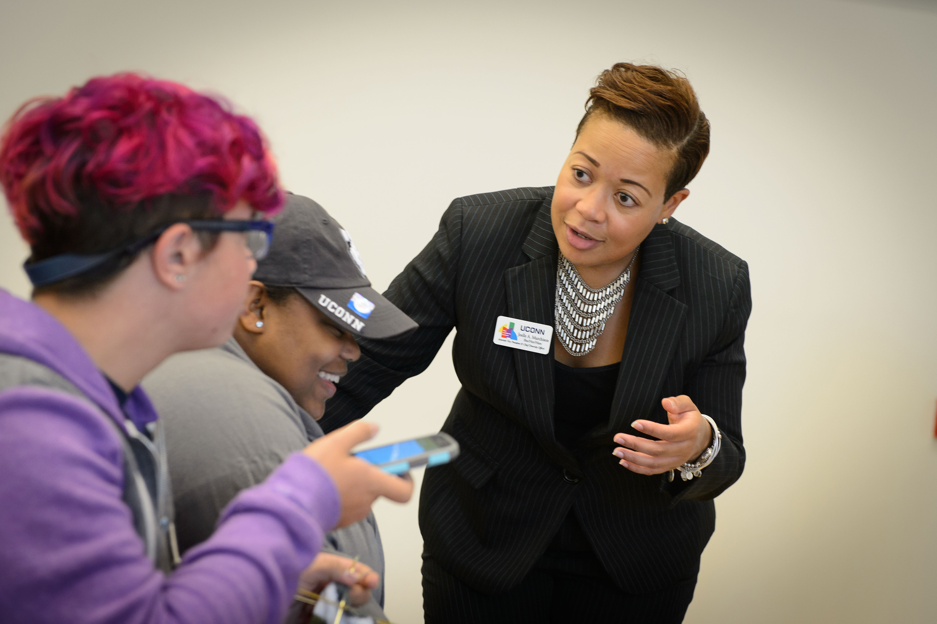 Associate vice president and chief diversity officer Joelle Murchison speaks with students before a forum on the recent violence seen in Orlando held at the Student Union Ballroom on Oct. 4, 2016. (Peter Morenus/UConn Photo)