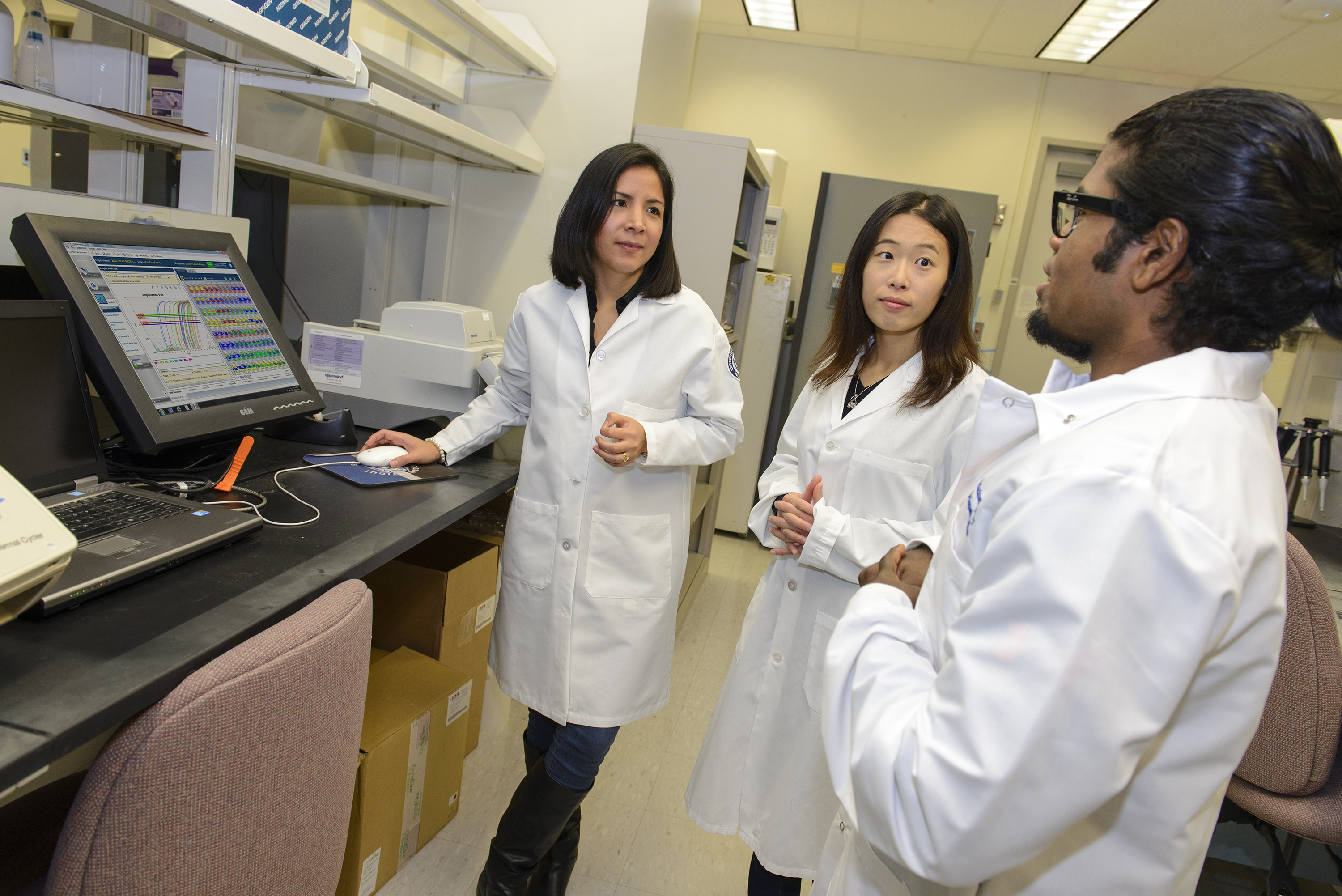 Denisse Tafur, Huakang Huang and Dinesh Babu Uthaya Kumar are UConn Graduate School students studying biomedical science who completed advanced training in translational research at the NIH's Clinical Center this summer.