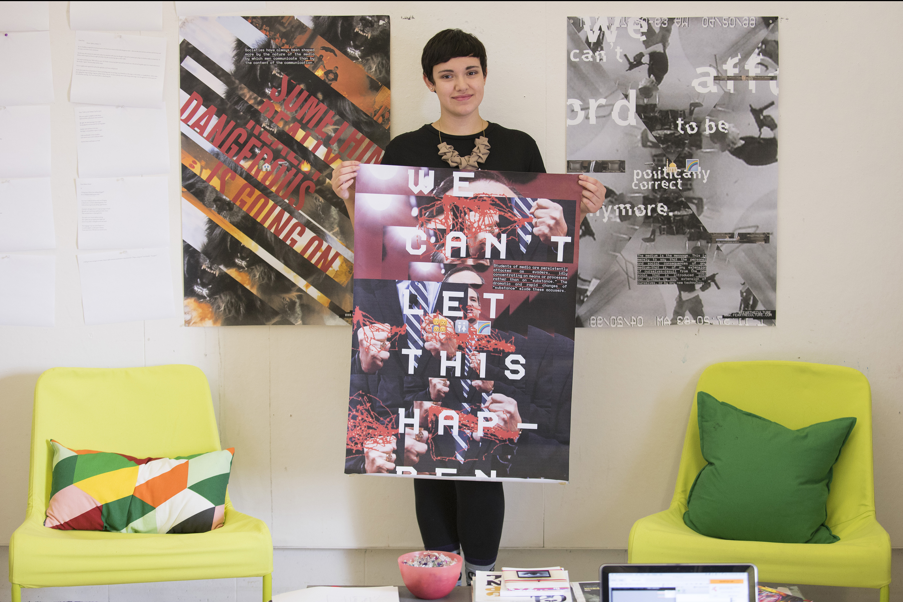IDEA Grant recipient Raeanne Nuzzo displays poster designs that incorporate images and language from this year's Presidential election campaign. (Sean Flynn/UConn Photo)