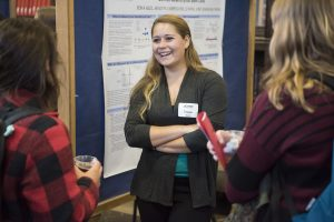 Tessa Kell '17 (CAHNR) discusses her research at the Fall Frontiers in Research Poster Exhibition in Wilbur Cross South Reading Room on Oct. 26, 2016. (Ryan Glista '16 (CLAS)/UConn Photo)