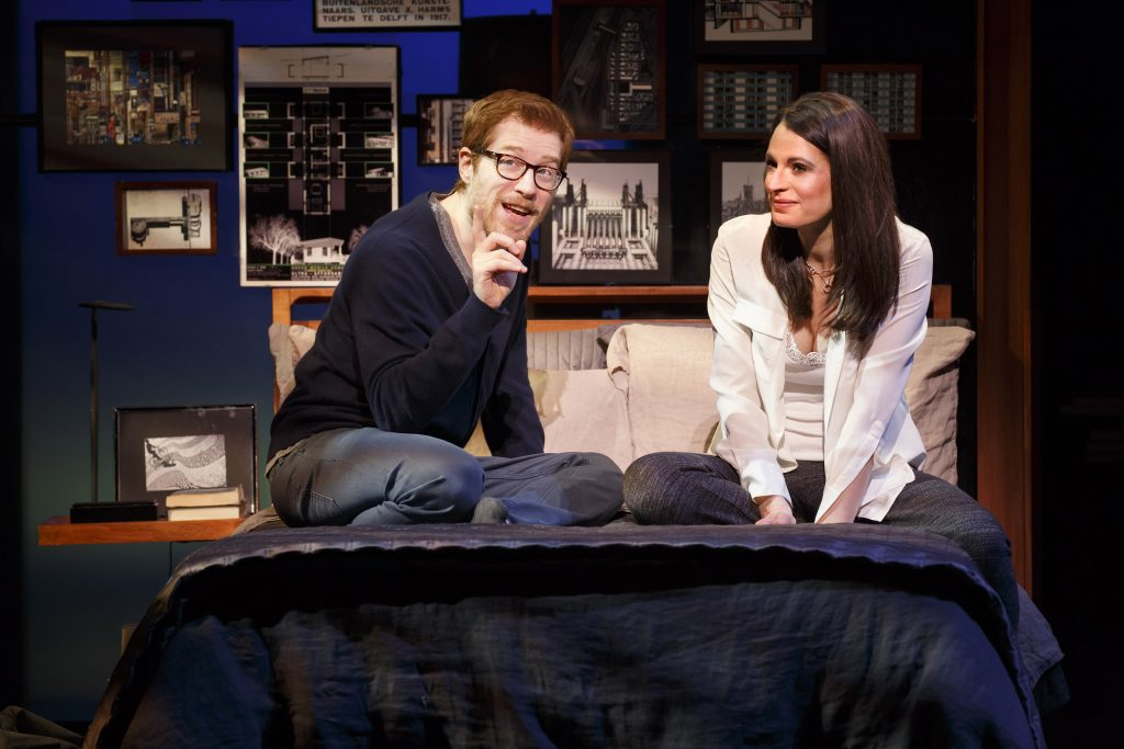 In 'If/Then,' Burns plays a woman whose life takes different paths in the form of two characters: Beth, above with best friend played by Anthony Rapp of 'Rent' fame, and Liz (top photo).