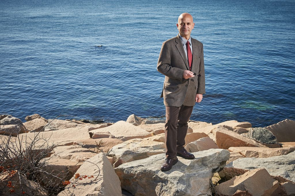 Kroum Batchvarov, assistant professor of anthropology, stands near Long Island Sound at the Avery Point campus on Nov. 18, 2016. (Peter Morenus/UConn Photo)