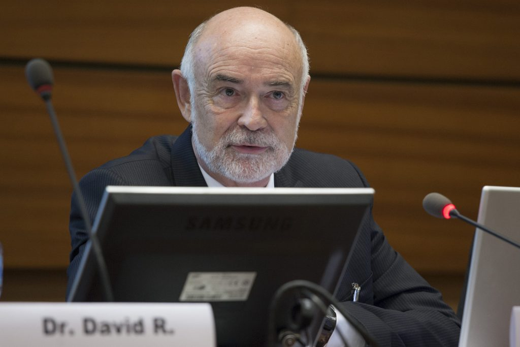 David Benson, professor of molecular and cell biology, at the Biological Weapons Convention Meeting of Experts in Geneva. At the meeting, he and colleagues presented a 'mini-university' on basic science concepts to international diplomats. (Photo by Eric Bridiers)