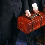Senate pages carry bound wooden boxes containing the Electoral College votes from the 50 states into the House of Representatives chamber at the U.S. Capitol on Jan. 4, 2013 in Washington, D.C. (Photo by Chip Somodevilla/Getty Images)