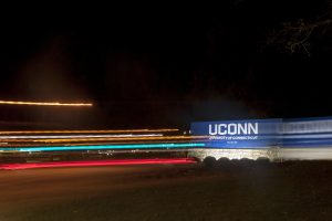 Night photos of the entrance sign to campus in motion on Nov. 10, 2016. (Sean Flynn/UConn Photo)