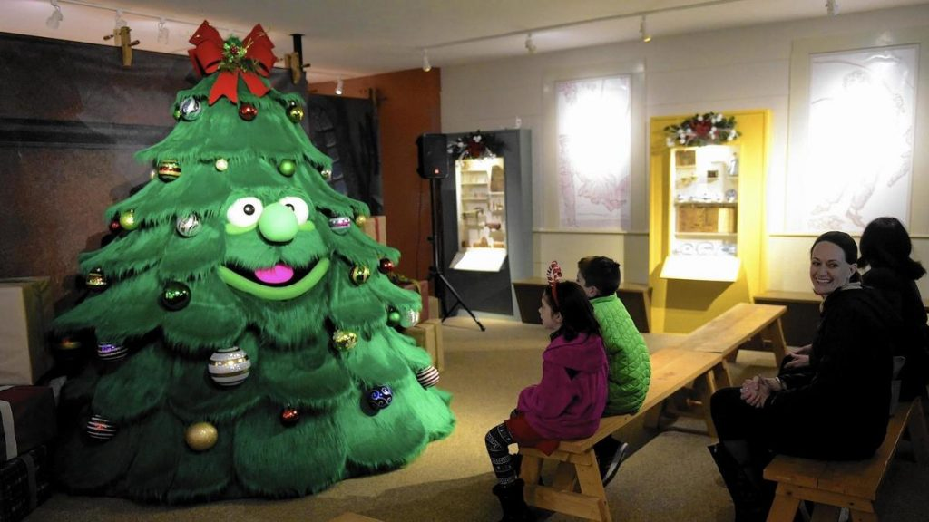 Children interact with Tinsel the Talking Christmas Tree in Old Sturbridge Village.