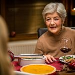 Senior woman in conversation at Christmas dinner. (vm/Getty Images)