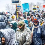 Winter has arrived in Standing Rock at the Oceti Sakowin Camp in North Dakota, the day after the Army Corps of Engineers denied the easement needed to build the pipeline. Despite driving snow and 40-plus mile an hour wind a group of 700-plus veterans and water protectors marched toward the barricade on highway 1806. (Photo by Michael Nigro/Pacific Press/LightRocket via Getty Images)