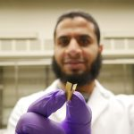 Chemistry Ph.D. student Islam Mosa holds an ultrathin implantable bioelectronic device he developed that is powered by a novel supercapacitor capable of generating enough power to sustain a cardiac pacemaker. It is more biocompatible and lasts much longer than existing pacemaker batteries. (Photo courtesy Islam Mosa)