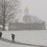 A snowy view of the Great Lawn toward looking toward the Wilbur Cross Building. (Peter Morenus/UConn File Photo)