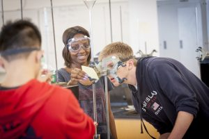 Conducting an experiment during chemistry class at Stamford on Oct. 19, 2016. (Sean Flynn/UConn Photo)