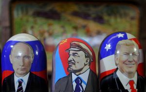 Traditional Russian wooden matryoshka doll with a picture of President-elect Donald Trump (right), Vladimir Lenin, a Soviet politician and statesman (center) and Russian President Vladimir Putin (left) at the fair on the Red Square in Moscow. (Photo by Danil Shamkin/NurPhoto via Getty Images)