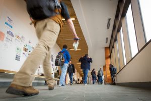 Busy hallway of Laurel Hall between classes on Jan. 17, 2017. (Sean Flynn/UConn Photo)