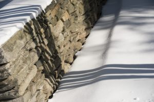 Shadows on a rock wall during winter on Jan. 9, 2017. (Sean Flynn/UConn Photo)
