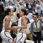 Napheesa Collier, left, and Gabby Williams celebrate the team's 100th consecutive win. (Stephen Slade '89 (SFA) for UConn)