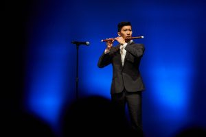 Kenneth Wong plays the flute during the Hong Kong Student Association's performance at Asian Nite. (Peter Morenus/UConn Photo)