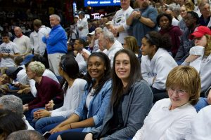 Former Husky greats Morgan Tuck, left, and Breanna Stewart were among the crowd at Gampel Pavilion. (Jack Templeton/UConn Photo)