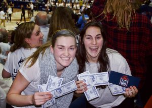 After the game, fake $100 bills featuring Coach Geno Auriemma's photo wafted down from the rafters. (Jack Templeton/UConn Photo)