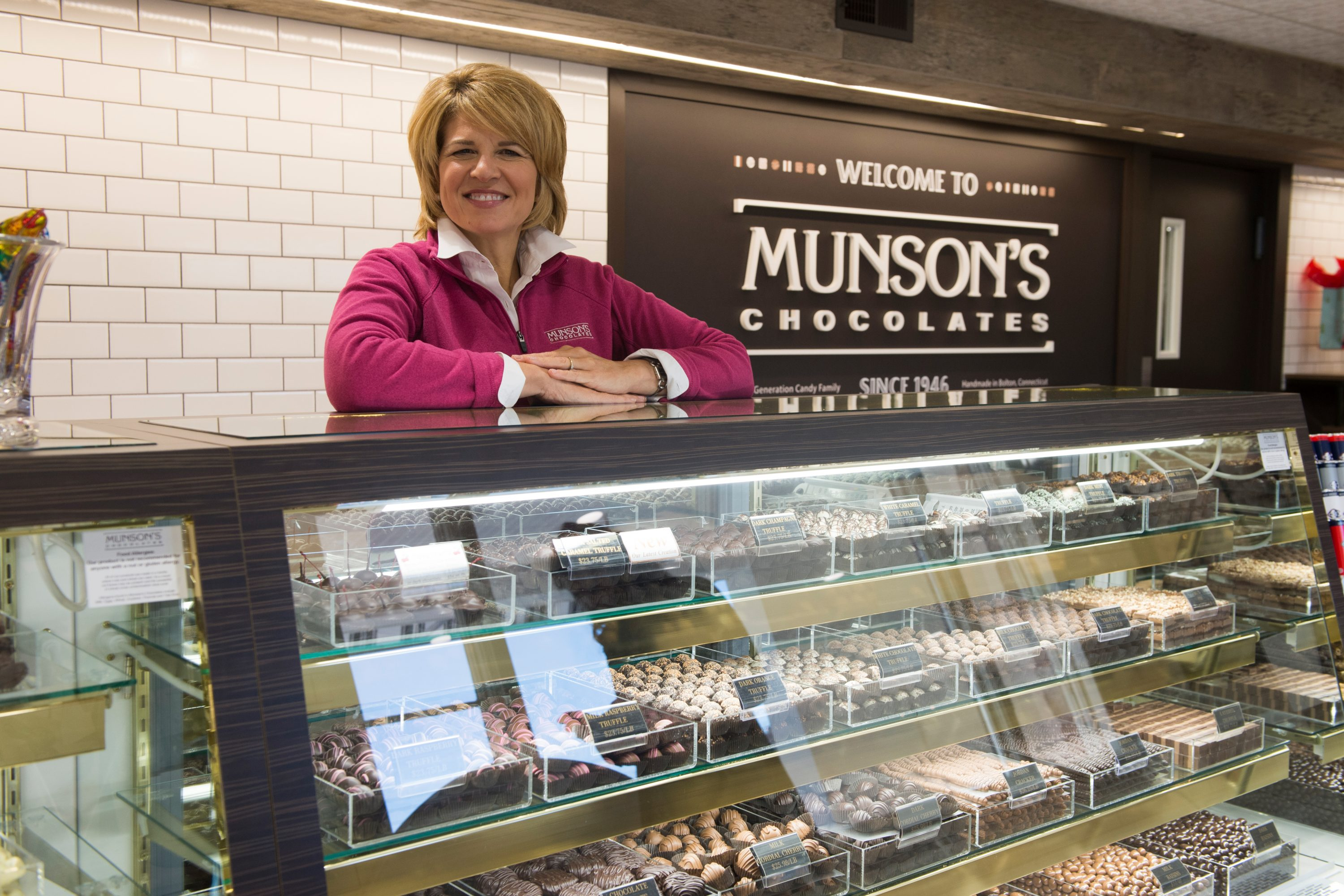 Karen Munson '86 (CLAS) stands at the counter at Munson's Chocolates in Bolton. (Peter Morenus/UConn Photo)