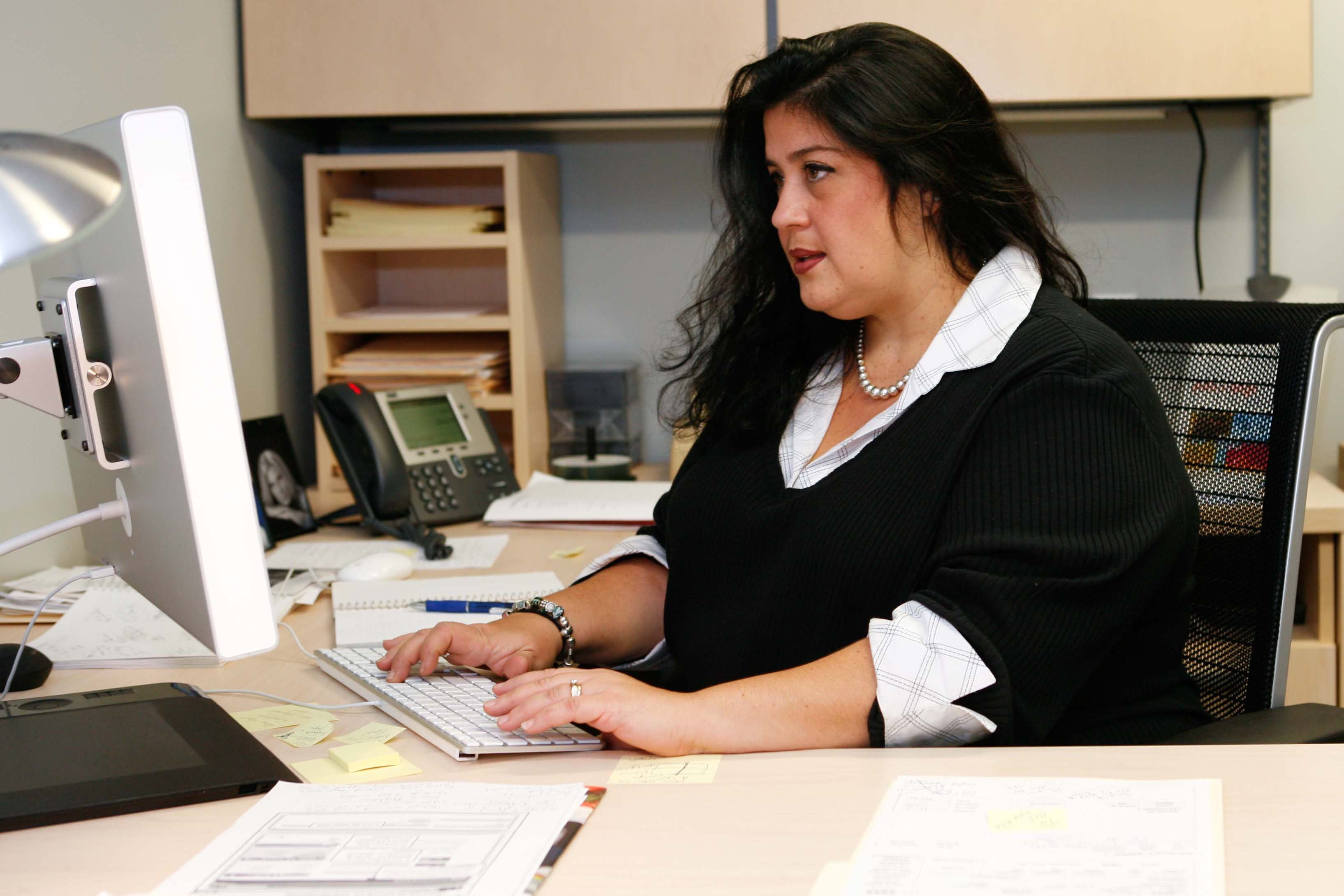 An overweight woman in an office. (Rudd Center Photo)