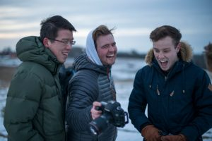 From left, Jason Jiang, Tyler Benton, and Scott Washburn of the UConn Photo Club share a photo taken on Horsebarn Hill on Feb. 2, 2017. (Ryan Glista/UConn Photo)