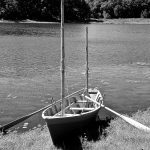 The photo shows a replica of Thoreau's best-known boat, Musketaquid, named for the Algonquian word for 'grassy plain,' used to describe the area that became the town of Concord. (Photo by Juliet Wheeler)