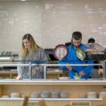 The dining department removed trays to cut down on washing and on the amount of food that is taken but not eaten. (Sean Flynn/UConn Photo)
