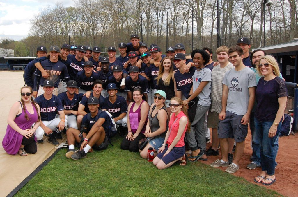 Music students and the baseball team gathered for a team photo on the field after the Huskies' win over Cincinnati on April 30. (Kenneth Best/UConn Photo)
