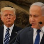 President Donald Trump listens as Israeli Prime Minister Benjamin Netanyahu speaks at a podium during Trump's recent Middle East visit. (REUTERS/Jonathan Ernst, via The Conversation)