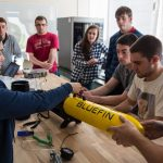 The Navy STEM Crew incorporates community building, education, leadership, and professional development components to inspire students and prepare them for Navy careers. Here, URI students from the Department of Ocean Engineering are conducting prep for an at-sea test of an autonomous underwater vehicle. (University of Rhode Island Photo)