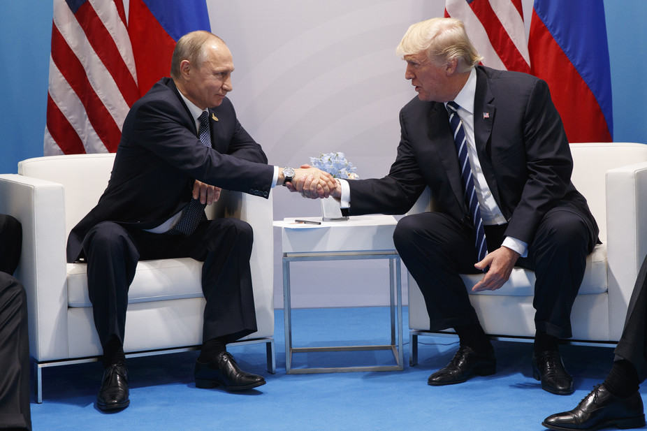 President Donald Trump shakes hands with Russian President Vladimir Putin at the G-20 Summit (AP Photo/Evan Vucci via The Conversation)