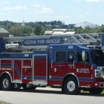 The new fire truck in the Horsebarn Hill area. The design integrates 'UConn blue' and the Husky logo in to the red exterior design. (Rob Babcock/UConn Photo)