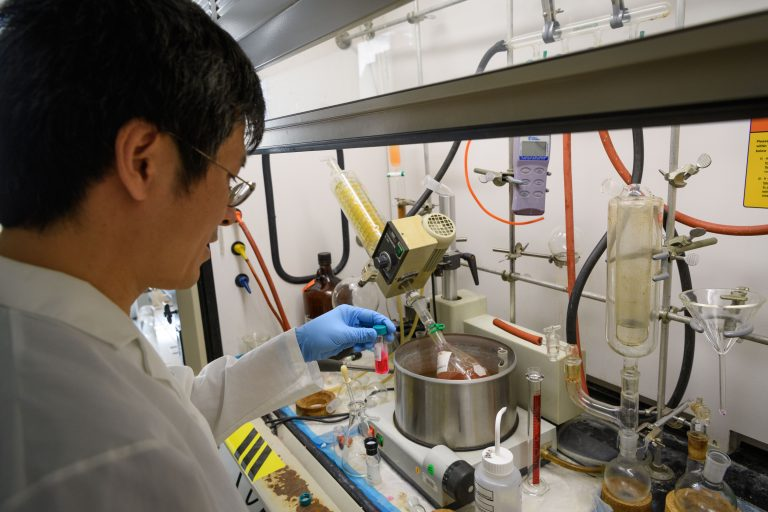 Ping Yan prepares voltage-sensitive dyes in the lab at the Cell and Genome Sciences Building at UConn Health in Farmington on Aug. 4, 2017. (Peter Morenus/UConn Photo)
