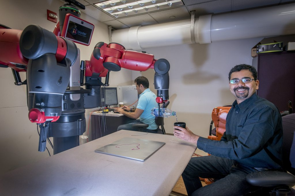 Ashwin Dani, assistant professor of electrical and computer engineering, is developing algorithms and software for robotic manipulation, to improve robots' interaction with humans. (Sean Flynn/UConn Photo)